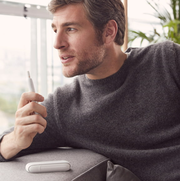 Man Holding IQOS 3 with Charger